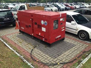 Generator placed on a parking lot